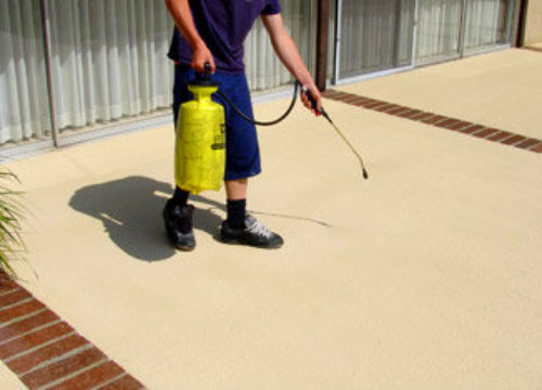 Applying concrete sealer by spraying